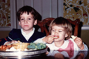 Olivia-and-Michael-eating-beer-cheese,-Dec-24-1984
